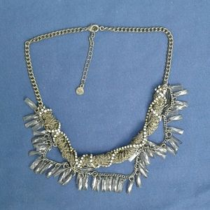 Edgy statement necklace with crystals and chains